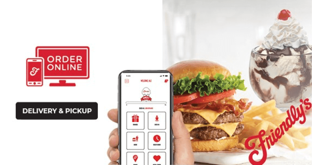 Mobile phone being held showing Friendly's mobile app with double cheese burger and vanilla sunday with chocolate syrup in the background